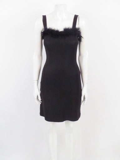 vintage 90's black mini dress with boa neckline trim. no closure, pullover style. super stretchy knit. boa is hanging off slightly detached at armpit (see photos).