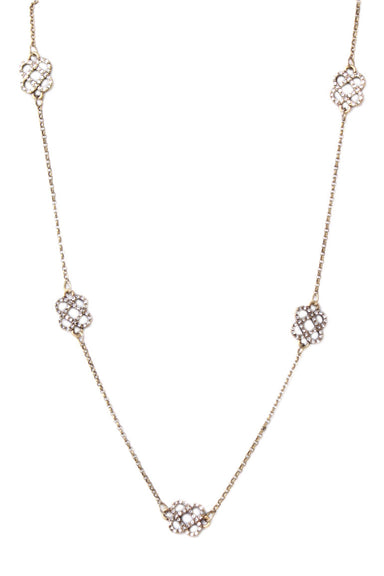 oscar de la renta gold tone necklace. features five charms evenly distributed with rhinestones, and an adjustable chain.
