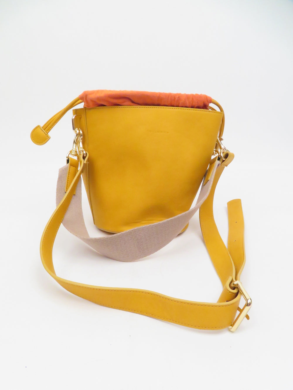 le.junev yellow and orange bucket bag. features dual strap and handle attachments. drawstring closure bucket top.
