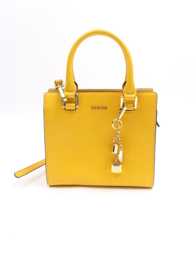 calvin klien bright yellow mini purse. features structured shape top zip closure with rolled top handles and shoulder strap