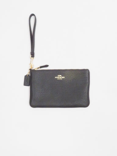 coach pebbled leather black wristlet. features gold hardware and brand detailing.