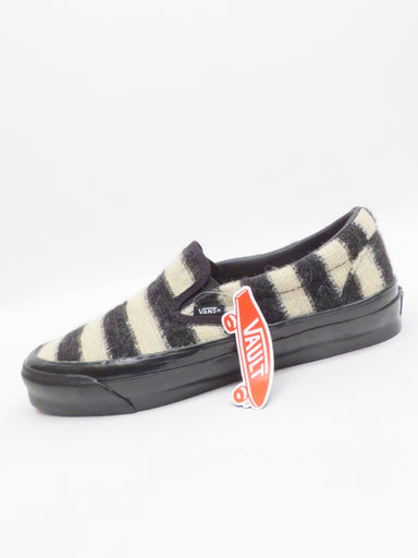 "concepts x vault by vans black and ivory slip-ons. features striped mohair upper and glossy black ~1.5"" outsole."