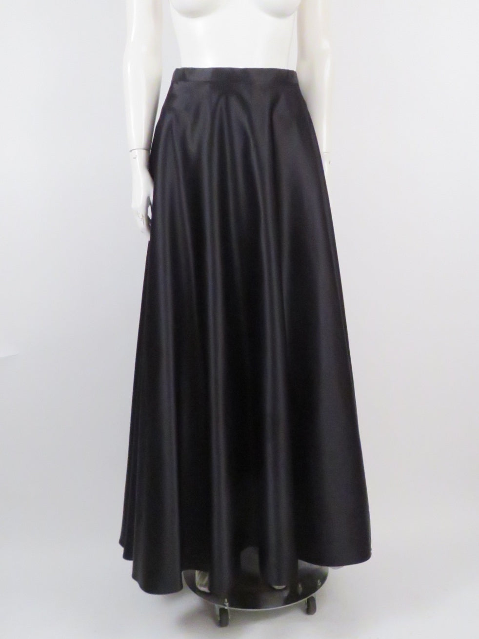 vintage faviana black maxi skirt features lining with crinoline bottom, hidden back zipper and a-line silhouette.