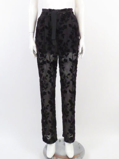 etro black shiny burnout velvet lounge pants. featuring a shiny floral burnout pattern. drawstring waist with zippered and hook clasp fly. pockets at sides.