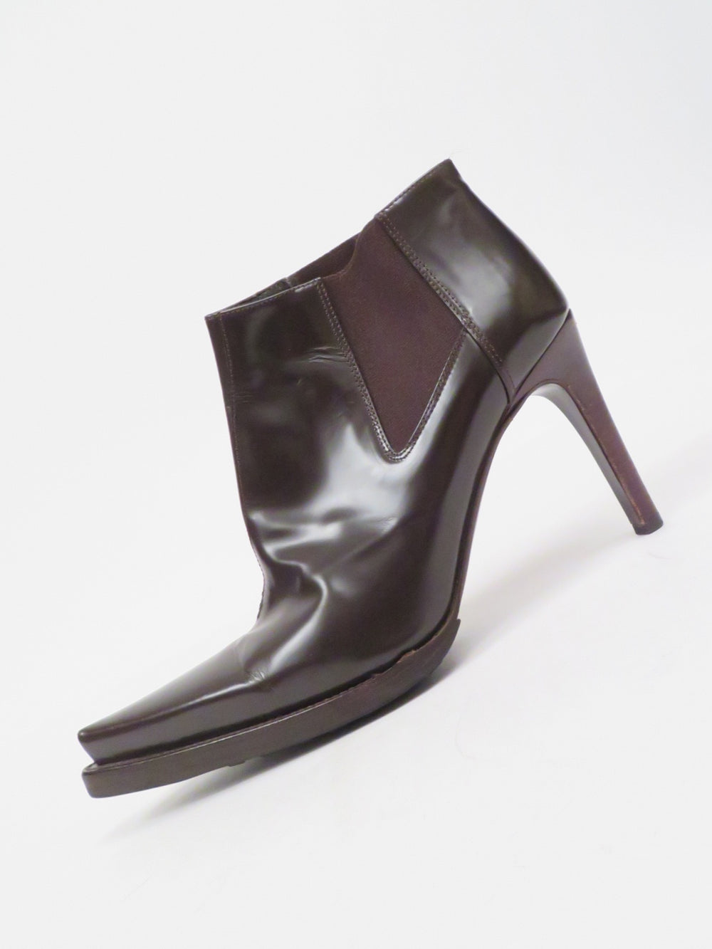 "miu miu brown pointed toe ankle boots. features stretch chelsea ankle with 4"" heel."