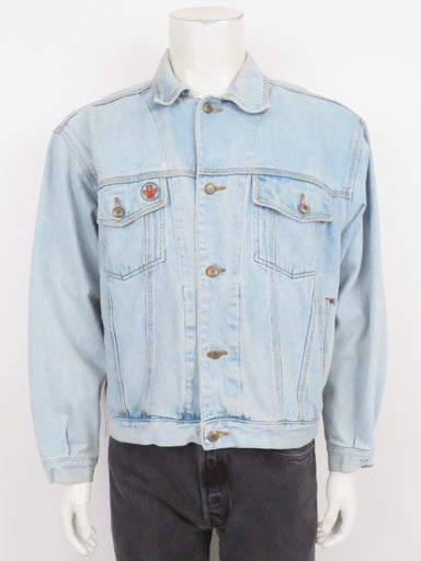 vintage bugle boy light blue denim jacket. features embroidered emblem at front pocket and oversized, cropped cut.