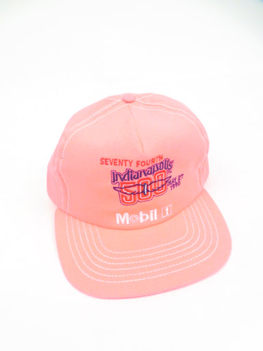vintage neon pink hat. features 'seventy fourth indianapolis 500 may 27 1990 mobil 1' graphic embroidered at front. adjustable snapback closure.