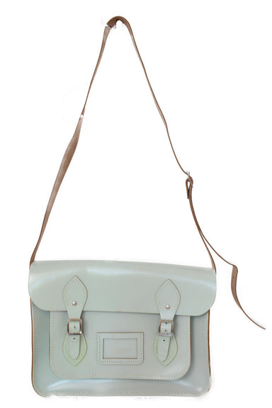 the cambridge satchel company mint blue bag. features front double buckle closures, and silver tone hardware.