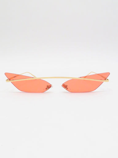 poppy lissiman red and gold skinny demon sunglasses. featuring floating lenses in an evil, pointed silhouette. a shiny gold metal bar which extends down the temples