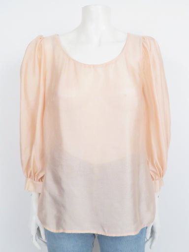 escada pale blush loosely-woven silk top. features elbow-length puff sleeves and hidden back button closure. relaxed cut, semi-sheer fabric.