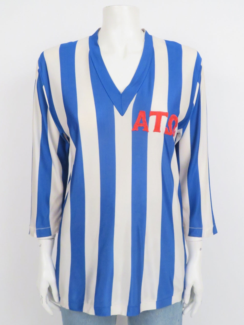 vintage blue and white striped knit fraternity jersey. features greek letter patches at front and v-neckline. elbow-length sleeves, regular cut.