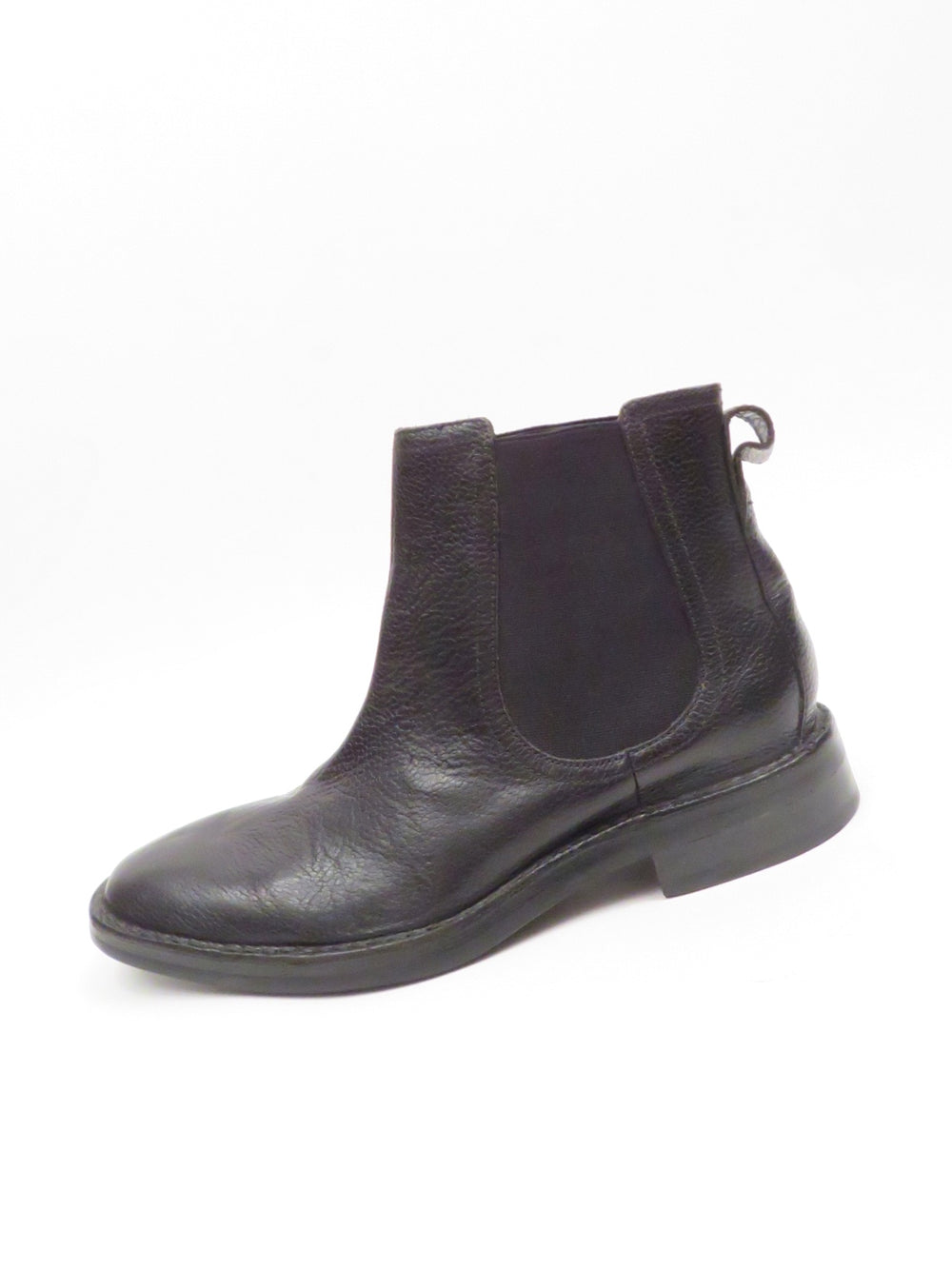 "cole haan black pebbled leather chelsea boots. features 'nike air' soles with ~ 1.25"" stacked heel."