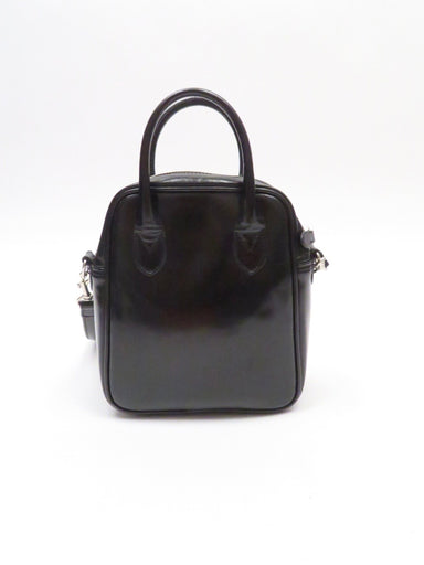 comme des garcon black mini purse. features silver hardware, top handles, and removable shoulder strap