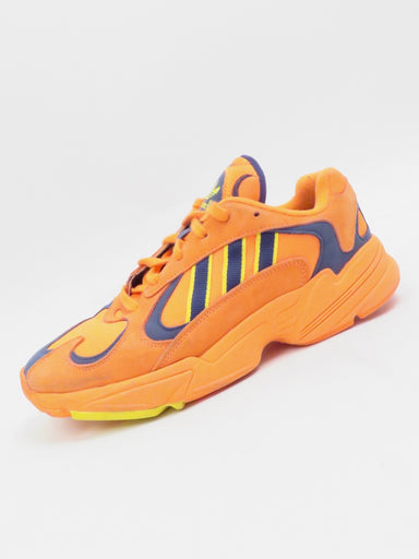description: adidas yung 1 hi-res orange sneakers. inspired by the 1997 falcon dorf heritage running shoe. some signs of wear (see photos).  color: hi-res orange, navy blue, yellow   size: 7.5 men's us, 9.5 women's us, 7 uk, 40 fr, 255 jp, 250 chn  fabrication: textile and suede upper, rubber sole  condition (all items are secondhand): fair/good pre-owned condition. signs of distressing.  country of origin: vietnam