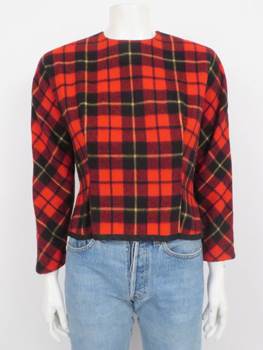 vintage red, black, and pale yellow plaid long sleeve wool top by unknown. features two-panel construction and black ribbon-lined hem. half-zip closures at back and left side seam, partially lined.