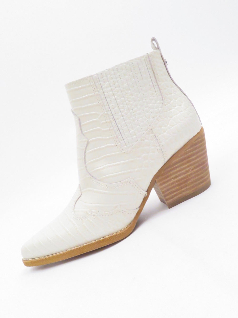 "sam edelman off-white 'winona' patent leather ankle boots. features crocodile-embossed leather and western design elements. pull-on style with hidden elastic side gussets. tapered toe with 2.5"" tan stacked heel."