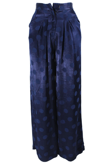 paper blue polka dot print wide leg pants. features pleating near waist, two side pockets, a concealed zipper & hook closure, & two accent back pockets.