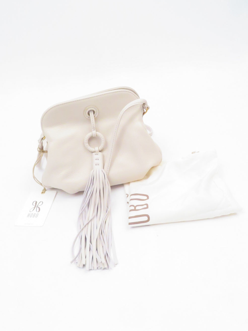 hobo 'birdie' crossbody slouchy leather bag in color 'dew'. features accordion style design and tassel detail. dust bag included.