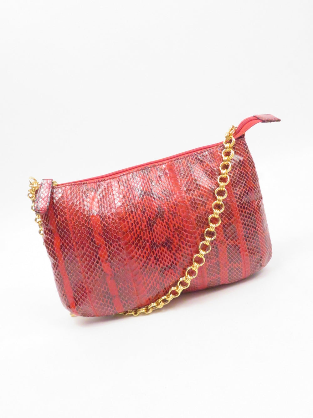bloomingdales red snakeskin bag. features paneled snakeskin outer and gold chain strap. lined.