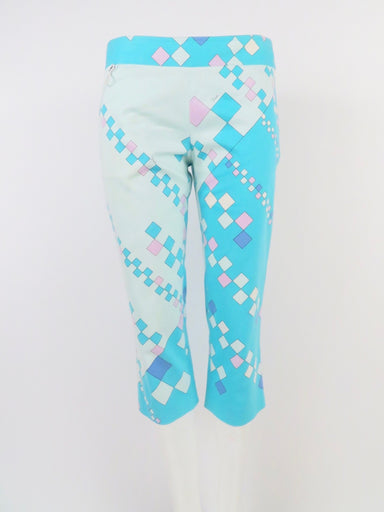 "description: emilio pucci turquoise geometric printed capri pants. mid rise. side zippered closure.   size: labeled 10 us, 44 it, 42 fr, fits more like a 4-6 us, small/medium  measurements: waist: 28"" hip: 41"" rise: 8.5""   fabrication: 98% cotton, 2% spandex  condition (all items are secondhand): good pre-owned vintage condition  country of origin: italy"