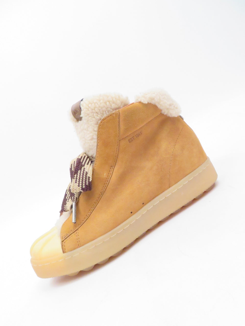 coach brown weather boots. features rubber type sole and toe with suede body and appears to be leather lining, sherpa type tongue and multicolor shoe lace tie.
