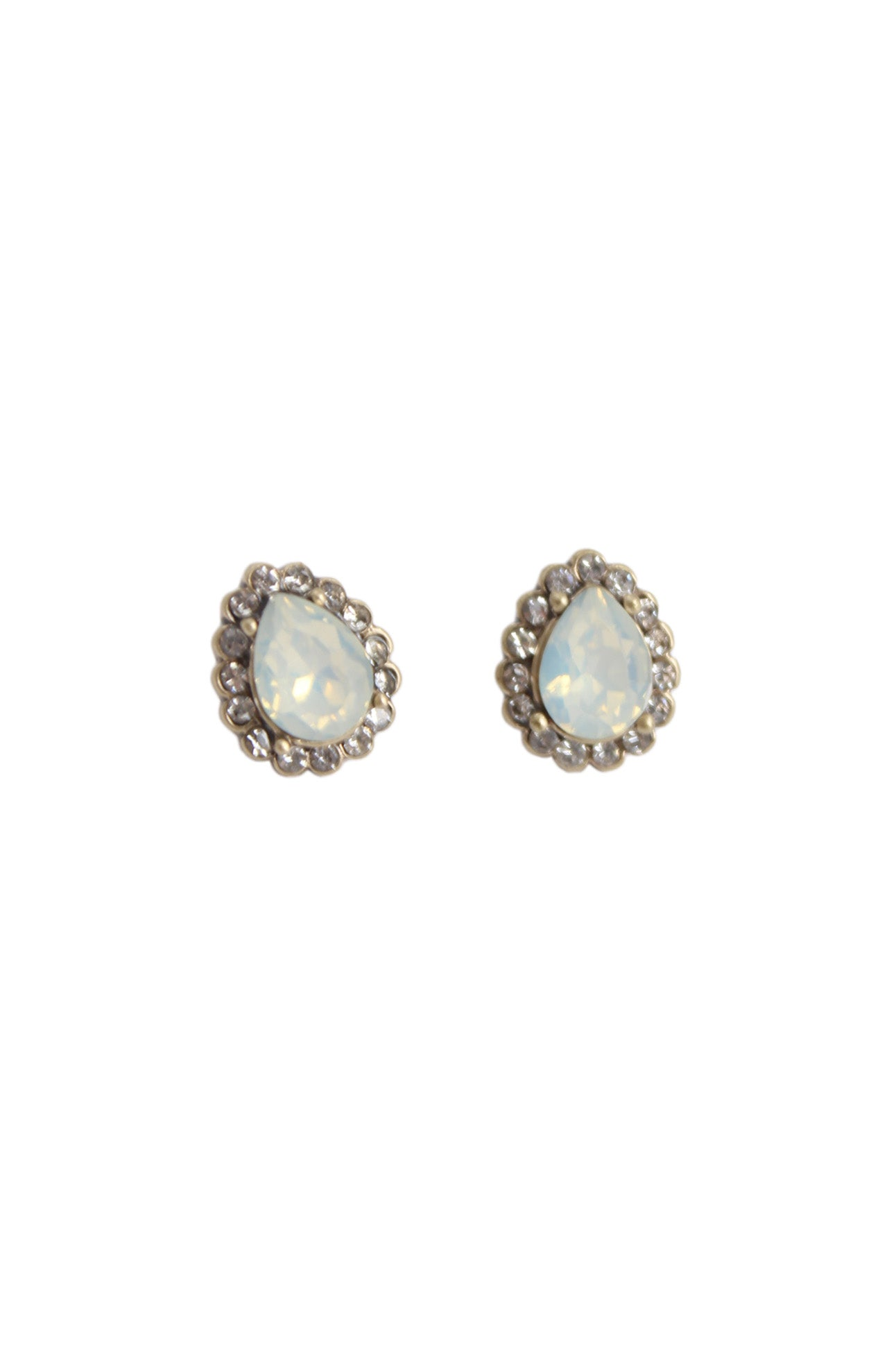unlabeled ice blue pear shaped gemstone earrings. featuring diamantes surrounding stone and pale gold metal hardware. with post back.