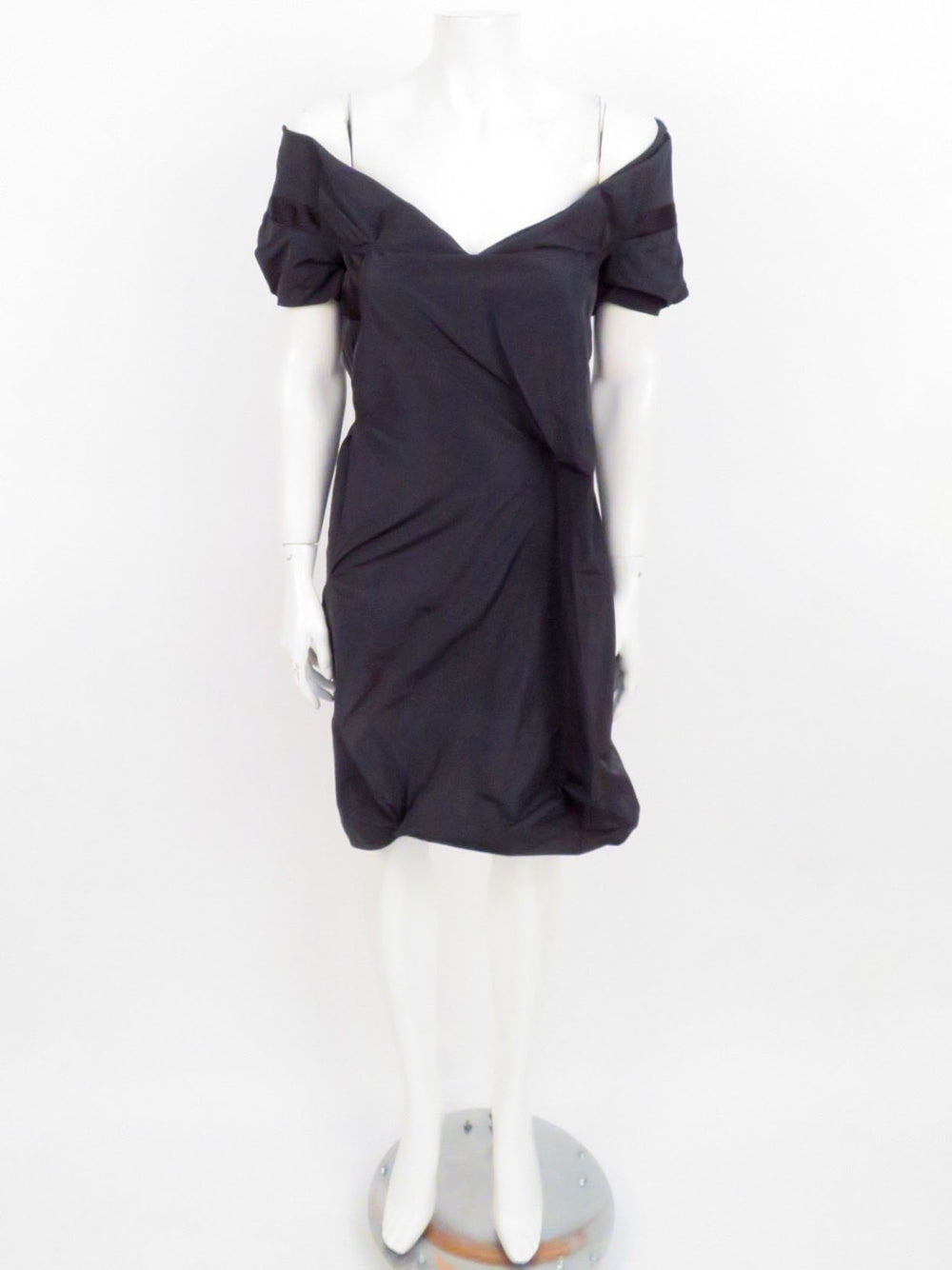 hussein chalayan black conceptual cocktail dress. beautiful wide v neckline. gathered/twisted conceptual design. back zippered closure.