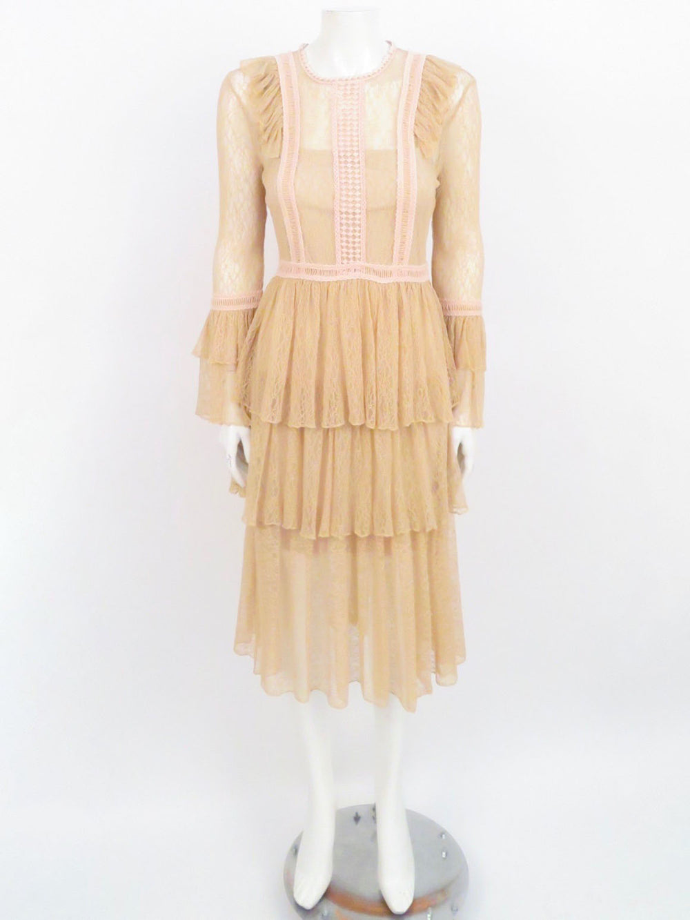 allison beige and pink lace frill dress. sheer beige lace, with pink trimming. back zippered closure. tonal slip included.