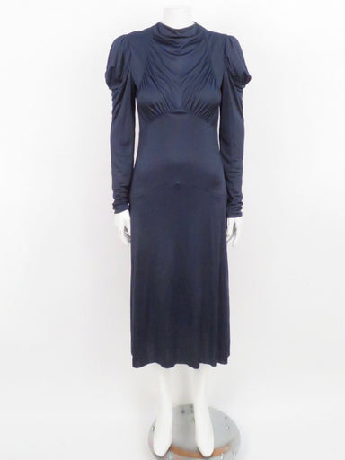 unlabeled navy slinky long sleeve drop waist dress. back zippered closure. 30's inspired silhouette.