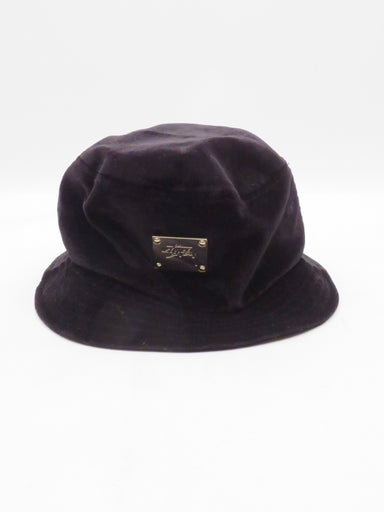 stussy black velour bucket hat. featuring a gold logo plaque at fro