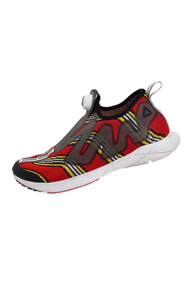 opening ceremony x reebok red instapump sneakers. features slip-on opening with a ventilated and vibrant jacquard upper, reebok's pump technology, an inflatable air bladder, wraps around the midfoot for a custom fit. opening ceremony branding is found throughout the forefoot and tongue tabs. the pump supreme midsole is constructed with carbonated foam for added cushioning.