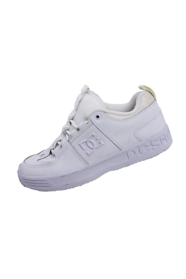 dc white leather 'lynx og' shoes. features tonal branding at tongue, sides and heel with top round lace closure.