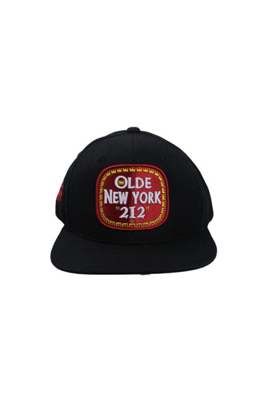 description: kb ethos black snapback. featuring olde new york patch and a green peek-a-boo visor.