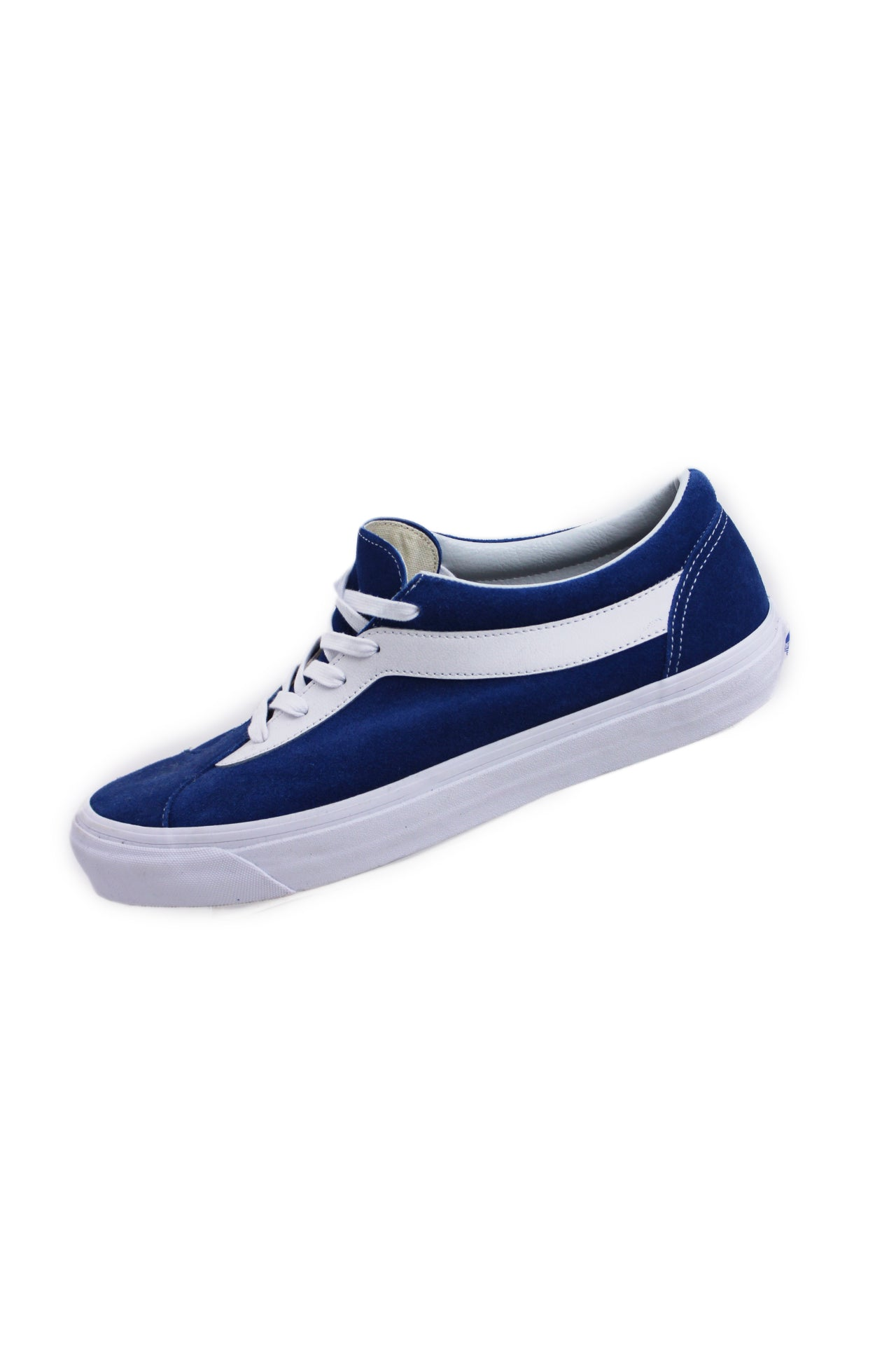 vans royal blue/white suede shoes. features large side stripe at sides, logo tab at heel, top flat lace closure, and a waffle grip sole.