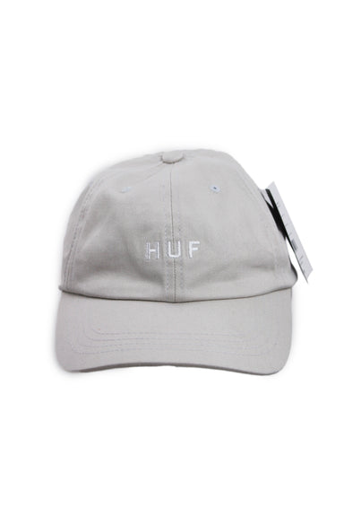 huf stone baseball cap. features white branding on front, eyelet vents, & adjustable strap at back.