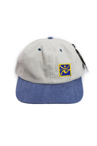 starter x olympics beige/blue unstructured six panel hat. features logos embroidered at front and back with adjustable strap/clasp closure at back.