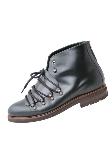 want les essentiels green boots. features green upper, brown sole, exaggerated black laces and silver tone hardware with gold zipper at heel.