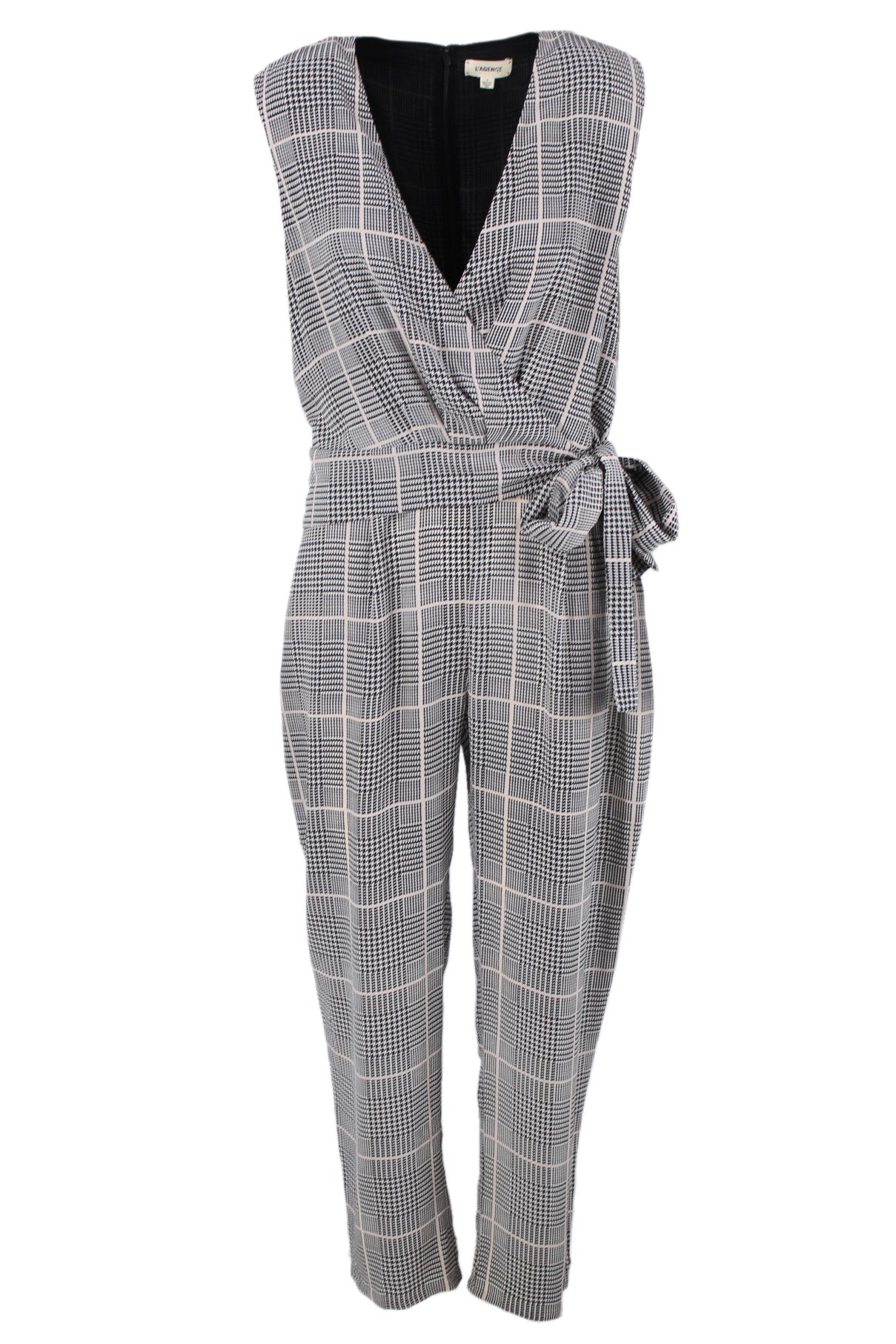 l'agence white & black houndstooth plaid print sleeveless jumpsuit. features a v neckline with a hook closure, self tie bow at waist, two side pockets, & a concealed back zipper closure.