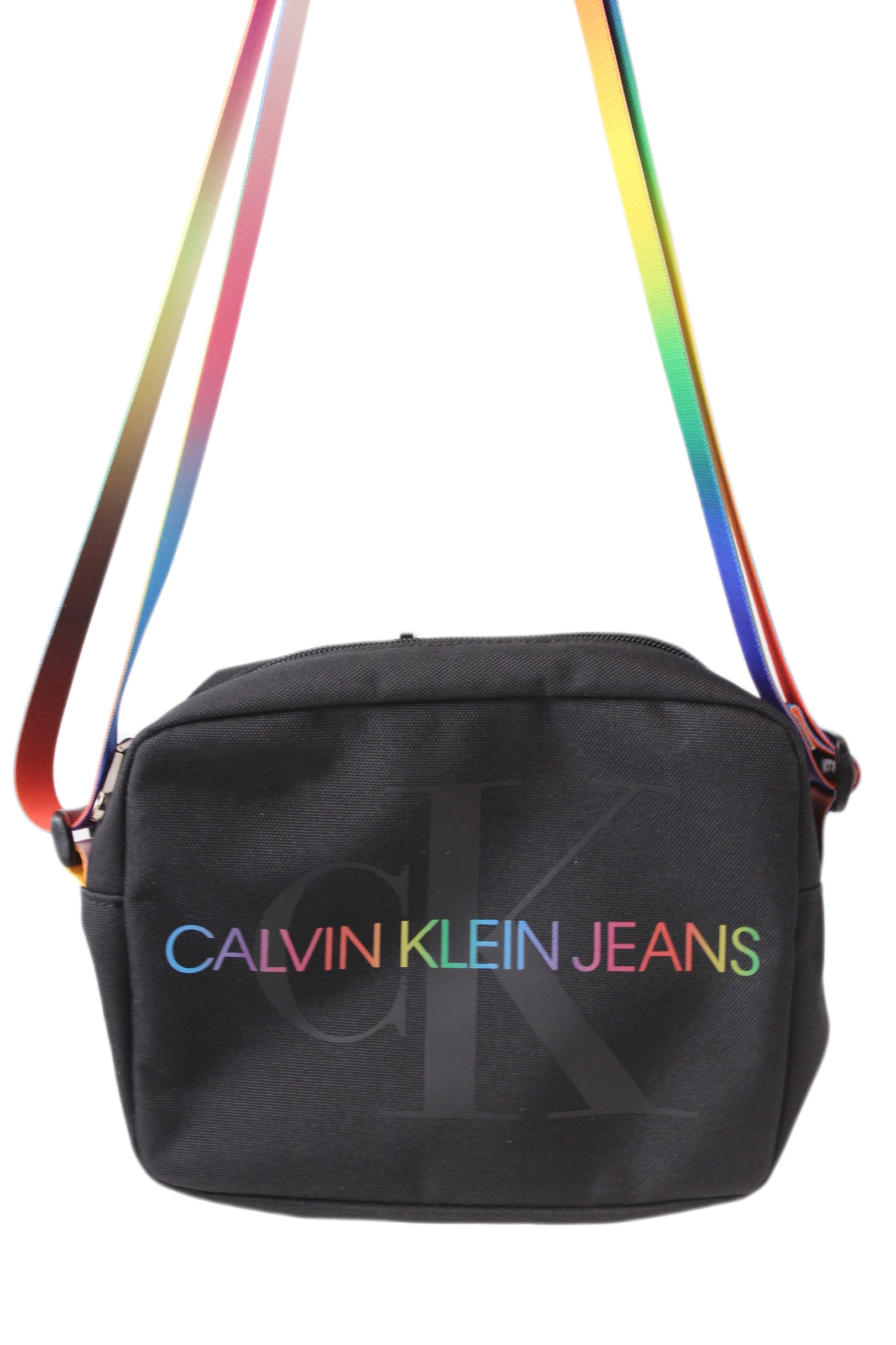 calvin klein jeans black and multicolored crossbody bag from their pride capsule collection. features signature rainbow logo on front and white logo on back, adjustable bag strap with a zip closure.