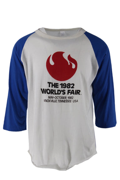 vintage white 1982 world's fair t-shirt. features rad flame image and black text at front with blue three-quarter raglan sleeves in a boxy cut.