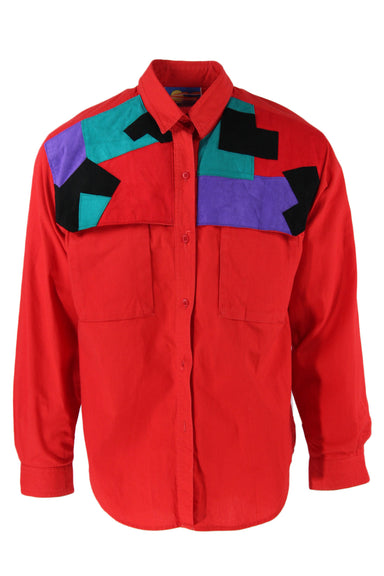vintage red long-sleeve button up top. features patch pockets at the chest, and a multicolor geometric design at the top of the chest. missing last button.sold as-is.