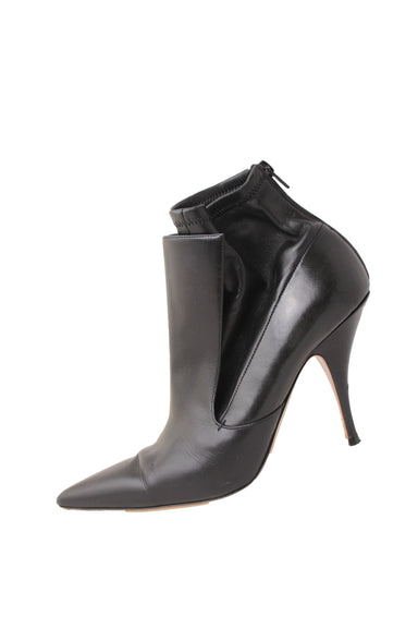 "givenchy black leather stiletto booties. featuring a pointed toe and 4"" stiletto heel. back zippered"