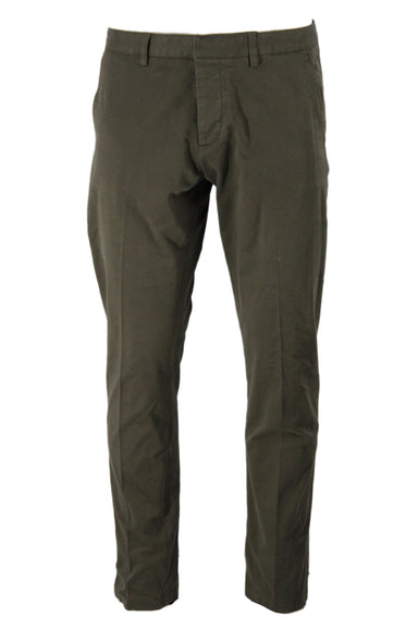 ami olive cotton twill pants. features tortoiseshell buttons at back welt pockets and fly closure with tonal branding embroidery at upper back. relaxed cut with slightly tapered leg. unlined.