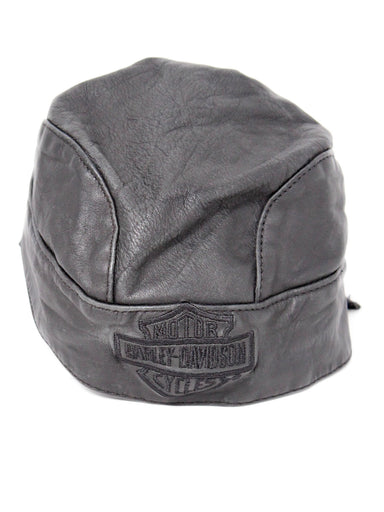vintage harley-davidson black leather hat. features tonal embroidered logo at front and tie closure at back. dated 1995 on inner care label.