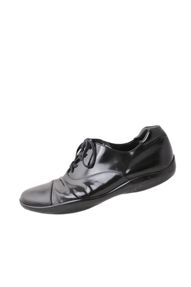 prada black patent leather men's shoes. featuring a sporty rubber sole and lace-up closure.