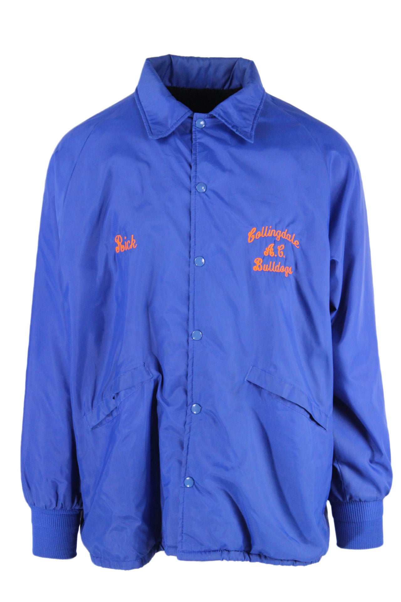 dunbrooke royal blue snap up coach jacket. features 'rick/collingdale bulldogs' embroidered at front, 'collingdale athletic club' embroidered with bulldog patch at back. hand pockets at front, ribbed at cuffs, and fully lined.