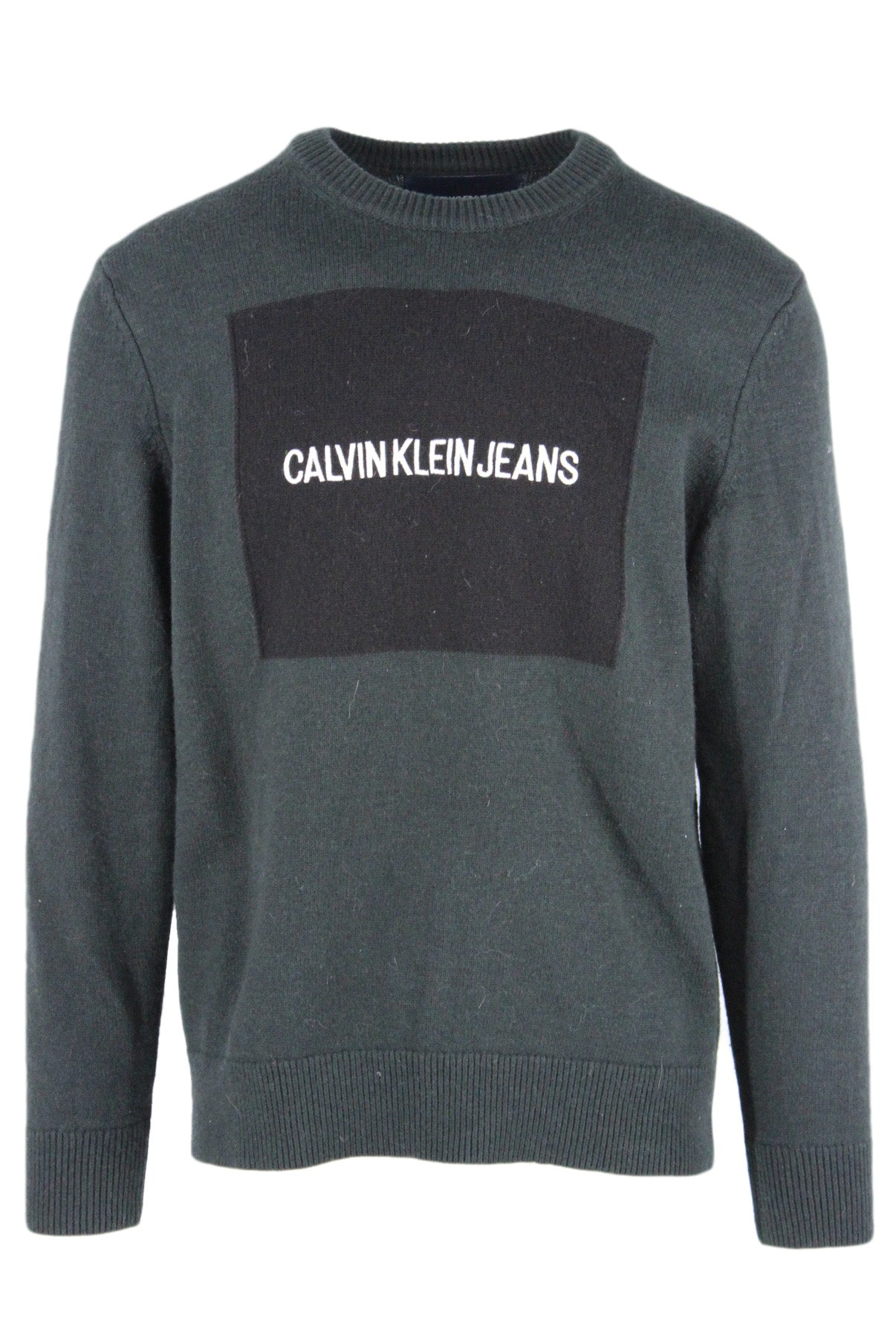 calvin klein jeans dark green pullover wool blend knit sweater. features 'calvin klein jeans' block logo embroidered at chest with ribbed collar, cuffs, and hem.