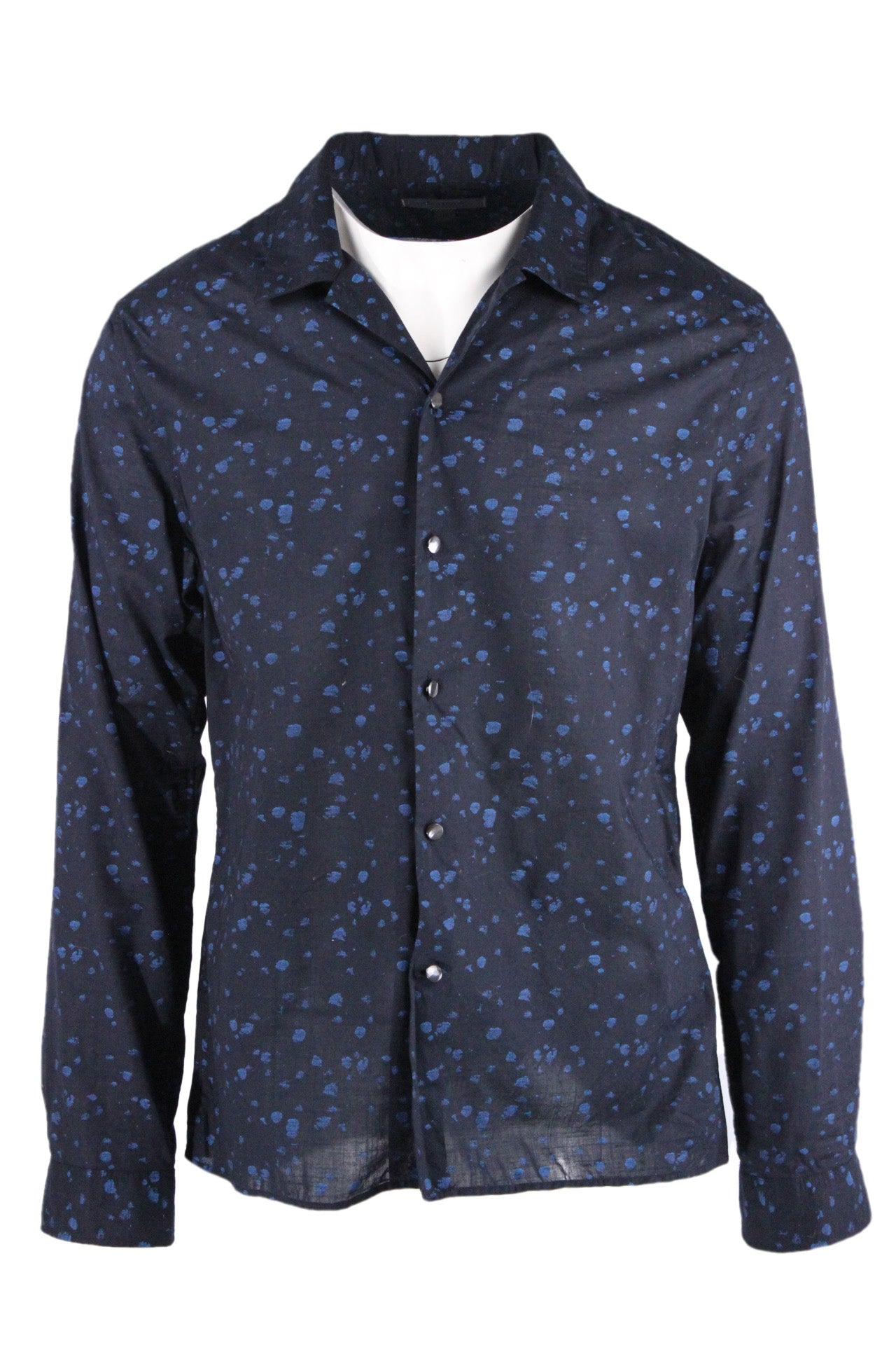 john varvatos black and cerulean blue semi-sheer speckled long sleeve shirt. features spatter-like bright blue print on reverse, leaving a distressed finish on exterior print. convertible collar with pearlized front button closure in a regular cut.