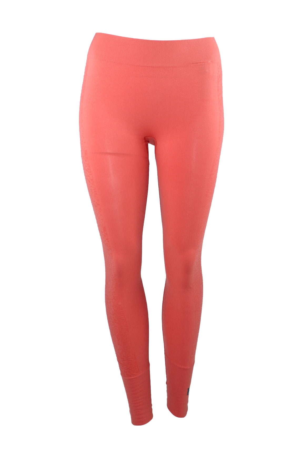 adidas x stella mccartney salmon seamless tights. features salmon tone exterior with ribbed panels throughout and textured panels at sides.