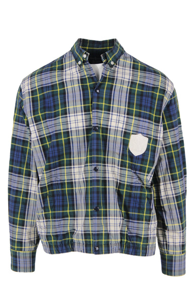 polo by ralph lauren blue and green plaid button down shirt. features blue and green plaid exterior, snap button closures, exterior pockets, ivory tone brand patch on chest, long sleeves and collar.